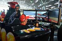 SÃO PAULO, SP, 03 DE MAIO DE 2013 - PREPARATIVOS FORMULA INDY: Tony Canaan em um simulador de corrida no pavilhão do Anhembi onde estão sendo feitos os preparativos das equipes para a etapa da Indy SP 300 que acontece neste final de semana no circuito de rua do Anhembi, zona norte de São Paulo. FOTO: LEVI BIANCO - BRAZIL PHOTO PRESS