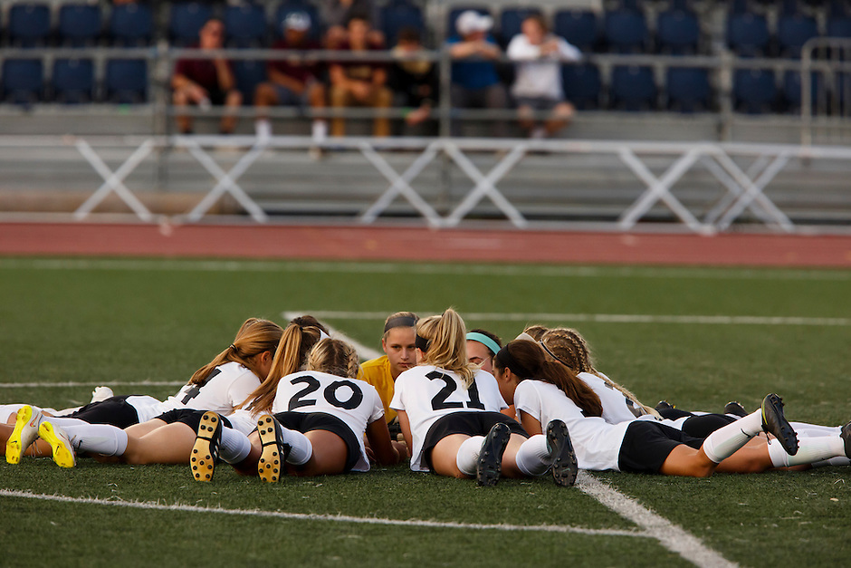Penn players huddle up before the IHSAA Class 2A Girls Soccer State Championship Game against Brebeuf Jesuit on Saturday, Oct. 29, 2016, at Carroll Stadium in Indianapolis. Special to the Tribune/JAMES BROSHER