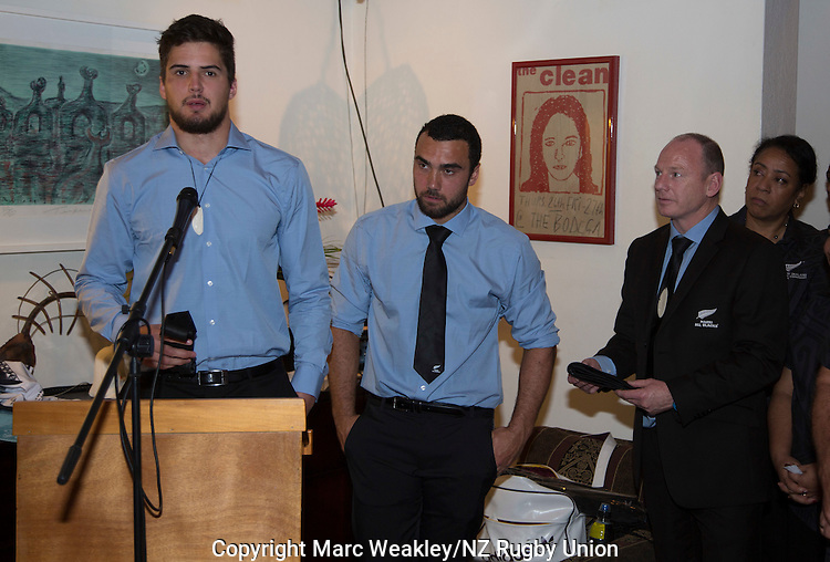 Jacob Skeen (L) receives his official debutant's Maori All Blacks tie at the post-match function at the NZ High Commission. At right is Captain Charlie Ngatai. July 11, 2015. Photo: Marc Weakley