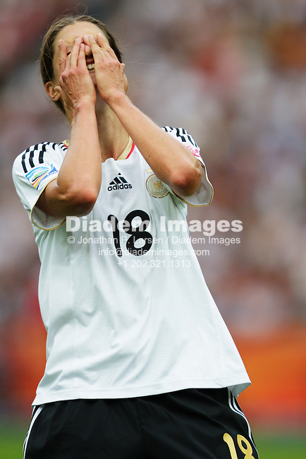 BERLIN - JUNE 26:  Kerstin Garefrekes of Germany reacts to a missed opportunity during the opening match of the FIFA Women's World Cup soccer tournament against Canada at Olympiastadion on June 26, 2011 in Berlin, Germany.  Editorial use only.  No pushing to mobile device usage.  Commercial use prohibited.  (Photograph by Jonathan Paul Larsen)