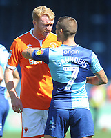 Blackpool's Chris Taylor remonstrates with Wycombe Wanderers' Sam Saunders<br /> <br /> Photographer Kevin Barnes/CameraSport<br /> <br /> The EFL Sky Bet League One - Wycombe Wanderers v Blackpool - Saturday 4th August 2018 - Adams Park - Wycombe<br /> <br /> World Copyright &copy; 2018 CameraSport. All rights reserved. 43 Linden Ave. Countesthorpe. Leicester. England. LE8 5PG - Tel: +44 (0) 116 277 4147 - admin@camerasport.com - www.camerasport.com
