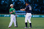 Tashiro Yasunori trainer of Japanese team (R) changing interactions and knowledge with Pakistanis player during the BFA Women's Baseball Asian Cup match between Pakistan and Japan at Sai Tso Wan Recreation Ground on September 4, 2017 in Hong Kong. Photo by Marcio Rodrigo Machado / Power Sport Images