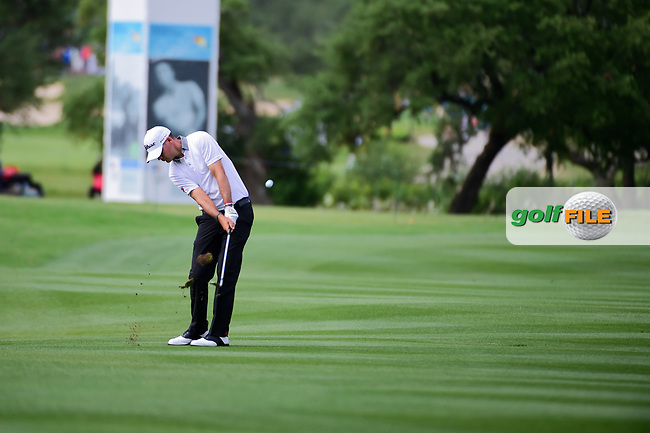 Tyrone Van Aswegen (RSA) hits his approach shot on 18  during round 2 of the Valero Texas Open, AT&amp;T Oaks Course, TPC San Antonio, San Antonio, Texas, USA. 4/21/2017.<br /> Picture: Golffile | Ken Murray<br /> <br /> <br /> All photo usage must carry mandatory copyright credit (&copy; Golffile | Ken Murray)