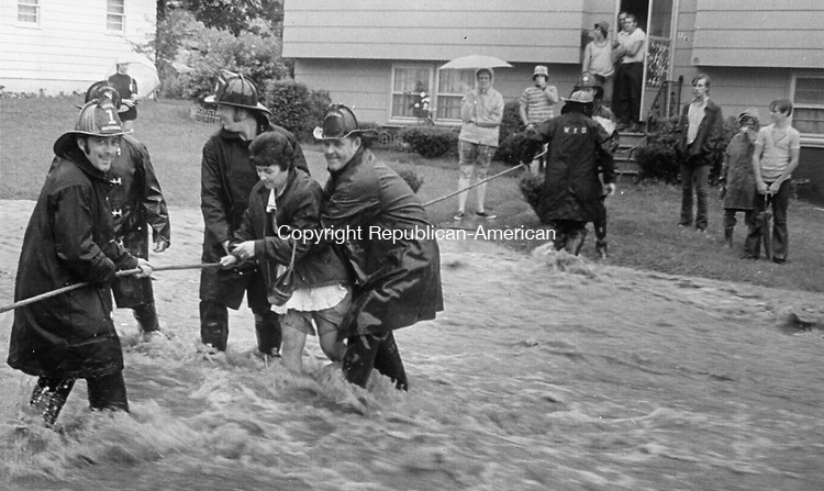Waterbury Firemen string a lifeline for a Kaynor Drive resident who wanted to get across the street during the flood of 1973.