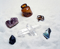 SILICA FORMS (SiO2) SILICON DIOXIDE<br /> On bed of sand.<br /> Clockwise from left: Amethyst, Glass, Jasper, Opal (hydrous silica), Picture Jasper, Smokey Quartz &amp; Rock Crystal Quartz.