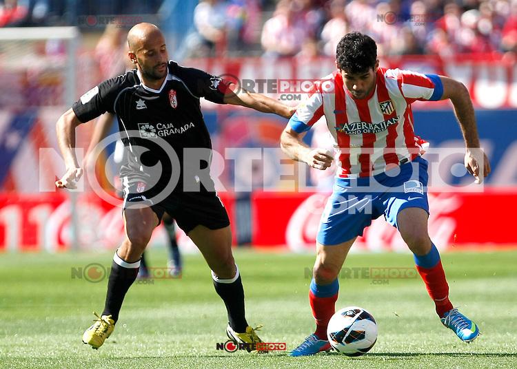 Atletico's Diego Costa and Granada's Mikel Rico during La Liga BBVA match. April 14, 2013.(ALTERPHOTOS/Alconada)