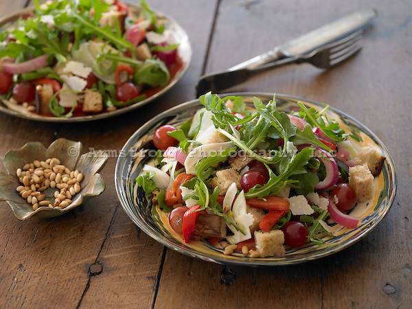 Bread salad with arugula, grapes, and pine nuts.