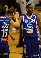 Kevin Owens encourages Ernest Scott after his fellow import missed a penalty shot during the NBL Round 12 match between the Wellington Saints and Nelson Giants at TSB Bank Arena, Wellington, New Zealand on Thursday 15 May 2008. Photo: Dave Lintott / lintottphoto.co.nz