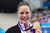 PICTURE BY ALEX BROADWAY /SWPIX.COM - 2012 London Paralympic Games - Day Three - Swimming - Aquatics Centre, Olympic Park, London, England - 01/09/12 - Sophie Pascoe of New Zealand poses with her Gold Medal after winning the Women's 100m Butterfly S10 Final.