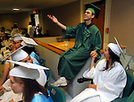 Nick Henri , who is a member Coventry High School Chorus, who were to perform in the graduation ceremony, serenades Lynda Chamberlain, prior to the Coventry High School graduation ceremony, Saturday, June 24, 2011, at the high school. (Jim Michaud/Journal Inquirer)