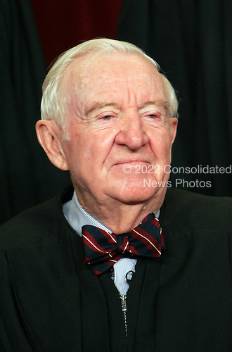 Associate Justice John Paul Stevens joins the members of the Supreme Court for photos during a group portrait session, at the Supreme Court Building in Washington, Friday, March 3, 2006. Stevens, 85, is the longest serving member of the current court. President Ford nominated him as an Associate Justice of the Supreme Court, and he took his seat Dec.19,1975.