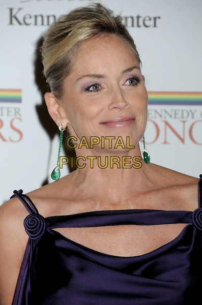 SHARON STONE .Gala Dinner honoring the 32nd Kennedy Center Honors held at the State Department, Washington DC, USA, .5th December 2009..portrait headshot green dangly earrings hair up emerald silk satin purple straps aubergine.CAP/ADM/LF.©Laura Farr/Admedia/Capital Pictures