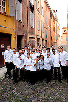 Massimo Bottura, 3 Michelin star chef and owner of Osteria Francescana in Modena, with his kitchen staff, Emilia Romagna, Italy
