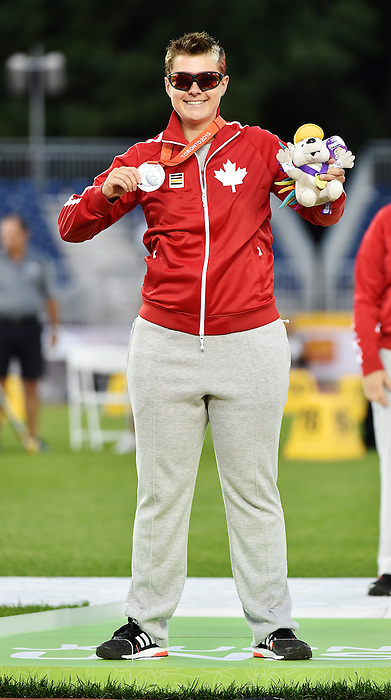 Toronto, ON - Aug 14 2015 - Ness Murby receives her Silver Medal for the Women's Javelin Throw F11/12 Final in the CIBC Athletics Stadium during the Toronto 2015 Parapan American Games  (Photo: Matthew Murnaghan/Canadian Paralympic Committee)