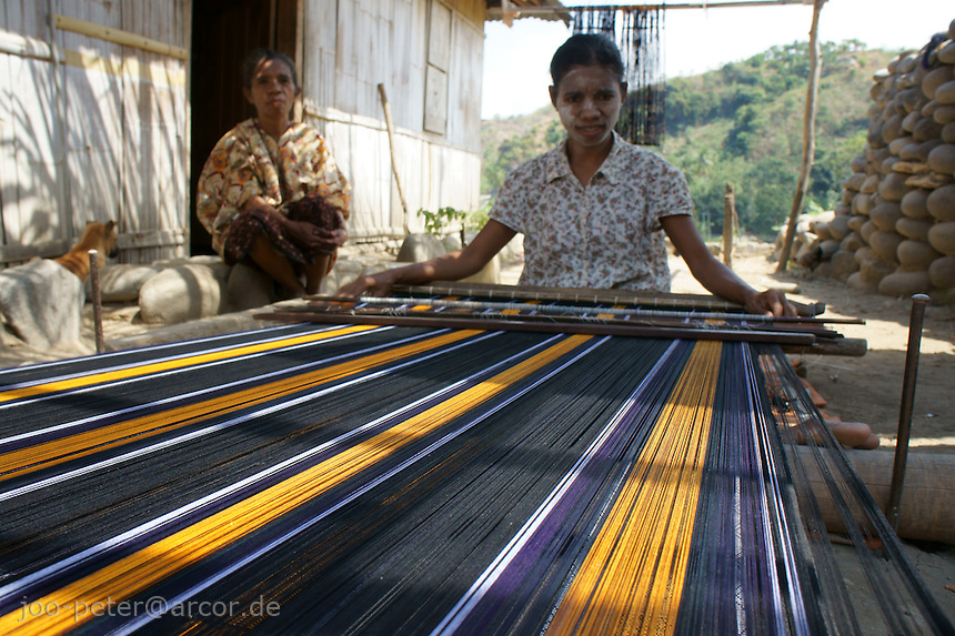 daughter of Julia weaving in fisher village Wolotopo,  island  Flores in archipelago of Indonesia