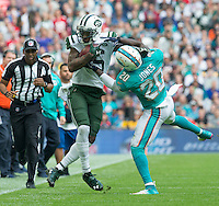 04.10.2015. Wembley Stadium, London, England. NFL International Series. Miami Dolphins versus New York Jets. Miami Dolphins Safety Reshad Jones tackles New York Jets Wide Receiver Brandon Marshall as he catches the ball in the first quarter.