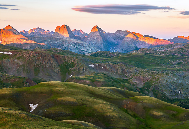 The rugged Grenadier Range rises above the rolling green tundra, Weminuche Wilderness