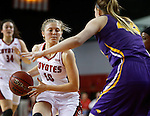 VERMILLION, SD - MARCH 24, 2016 -- Allison Arens #10 of South Dakota looks past Northern Iowa defender Alyssa Johnson #44 during their WNIT game Thursday evening at the Dakotadome in Vermillion, S.D.  (Photo by Dick Carlson/Inertia)