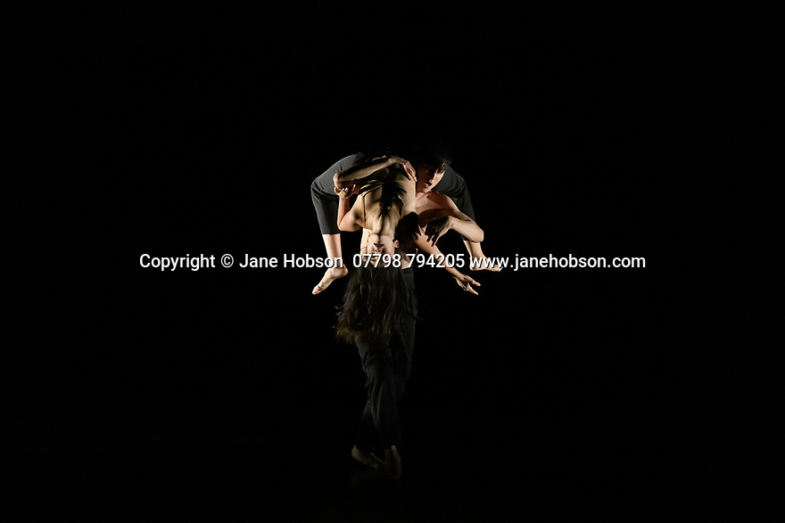 """Rambert2 presents """"Sin"""", at Sadler's Wells theatre, choreographed by Sidi Larbi Cherkaoui and Damien Jalet, with lighting design by Adam Carree and costume design by Alexandra Gilbert. Picture shows: Melody Tamiz and Chen Peng."""