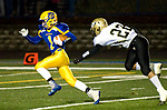 SEYMOUR, CT-112217JS02- Seymour's Ethan Szerszen (1) avoids a tackle by Woodland's Matt Mills (22) for a touchdown run during their game Wednesday at Seymour High School. Seymour defeated the Hawks  56-8. Jim Shannon Republican-American