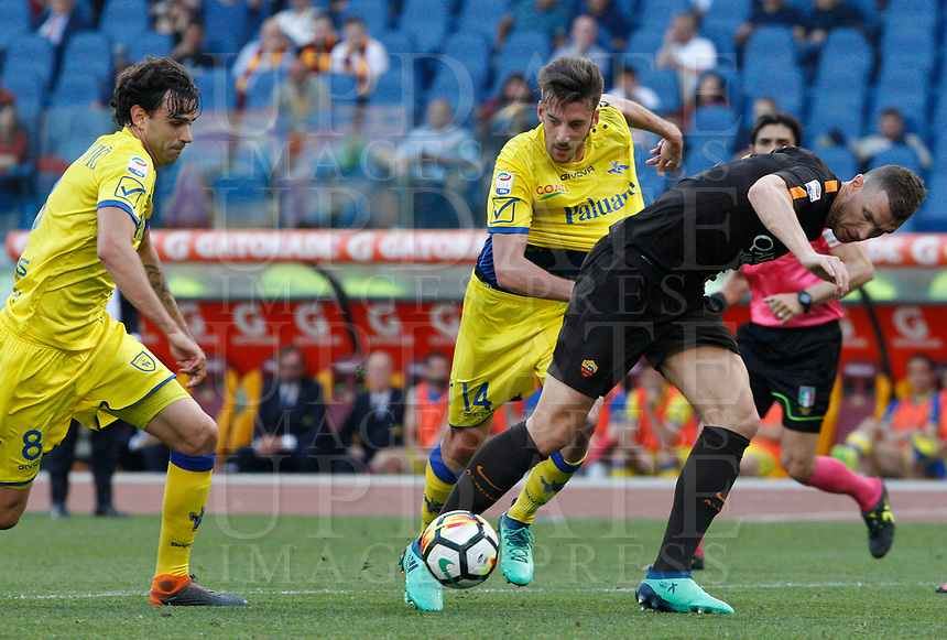 Roma s Edin Dzeko, right, is challenged by Chievo Verona s Ivan Radovanovic, left, and Mattia Bani, during the Italian Serie A football match between Roma and Chievo Verona at Rome's Olympic stadium, 28 April 2018.<br /> UPDATE IMAGES PRESS/Riccardo De Luca