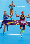 Mcc0041438 . Sunday Telegraph..ST Sport..2012 Olympics..Swiss Nicola Sprig crosses the finish line in first place with sweden's Lisa Norden 2nd and Australia's Erin Densham 3rd..The Women's Olympic Triathlon in London's Hyde Park..4 August 2012....
