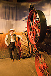 Minnesota, Twin Cities, Minneapolis-Saint Paul: Mill City Museum, showing flour milling history in Minneapolis. Re-enactor with steam tractor..Photo mnqual250-75338..Photo copyright Lee Foster, www.fostertravel.com, 510-549-2202, lee@fostertravel.com.