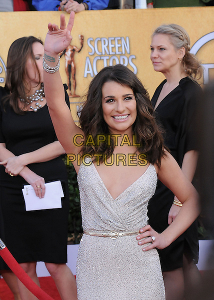 LEA MICHELE .at the 17th Screen Actors Guild Awards held at The Shrine Auditorium in Los Angeles, California, USA, .January 30th 2011..SAG Sags arrivals full length white silver dress low cut  hand on hip skinny belt platform shoes grey gray beige bracelet gold sparkly  arm raised up waving .CAP/RKE/DVS.©DVS/RockinExposures/Capital Pictures.