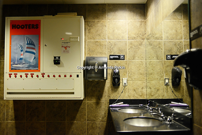 A pantyhose dispenser and curling iron are seen in the women's restroom at a Hooters in Birmingham, Alabama on January 8, 2013.
