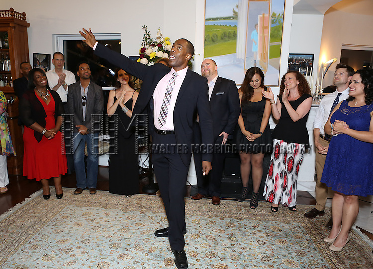 Michael McElroy and singers perform at 'Parlor Night' A benefit evening for The Broadway Inspirational Voices Outreach Program at the home of Roy and Jenny Neiderhoffer on June 22, 2015 in New York City.