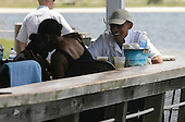 United States President Barack Obama eats lunch at Lime's Bayside Bar and Grill with First Lady Michelle and daughter Sasha at Panama City Beach, Florida USA on Saturday, 14 August  2010.  The First Family is visiting the area to help promote tourism and check up on clean up efforts from the aftermath of the Deepwater Horizon Oil spill.  .Credit: Dan Anderson / Pool via CNP