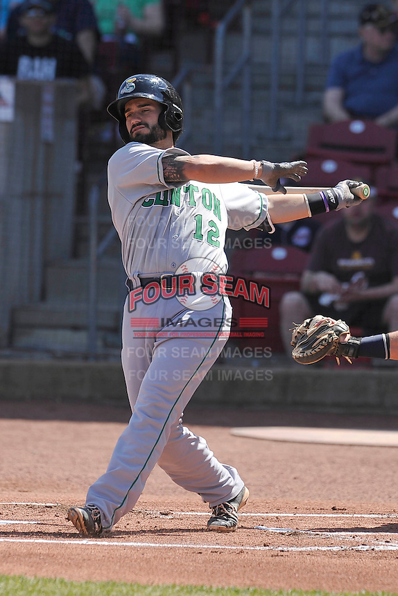 Clinton  LumberKings James Alfonso (12) swings during the game against the Cedar Rapids Kernels at Veterans Memorial Stadium on April 17, 2016 in Cedar Rapids, Iowa.  Clinton won 7-2.  (Dennis Hubbard/Four Seam Images)