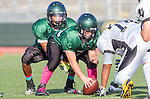 Torrance, CA 10/03/13 - unidentified Peninsula player(s) and unidentified South Torrance player(s) in action during the Peninsula vs South Torrance Freshmen football game at South Torrance High School.