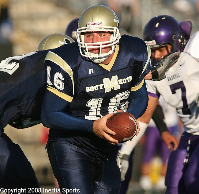 RAPID CITY SD -- AUGUST 30 -- South Dakota Tech quarterback Nick Russell spins to hand off in the first quarter of their game against Haskell University Saturday evening at O'Harra Stadium in Rapid City. (Photo by Dick Carlson/Inertia)
