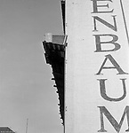 Pittsburgh PA:  View of the building demolition of one of downtown Pittsburgh's grand department stores, Rosenbaums. Located at Penn Avenue and Sixth Street in Pittsburgh, the store closed in 1960 and taken down in 1963 to make way for the Sixth Avenue garage.  The demolition work was completed by D&H Building Wreckers.