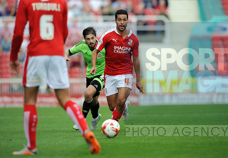 Fabien Robert of Swindon Town is challenged by Kieron Freeman of Sheffield United<br /> - English League One - Swindon Town vs Sheffield Utd - County Ground Stadium - Swindon - England - 29th August 2015