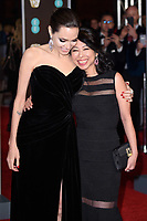 Angelina Jolie and Loung Ung<br /> arriving for the BAFTA Film Awards 2018 at the Royal Albert Hall, London<br /> <br /> <br /> ©Ash Knotek  D3381  18/02/2018