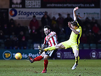 Lincoln City's Neal Eardley vies for possession with  Cheltenham Town's Kevin Dawson<br /> <br /> Photographer Andrew Vaughan/CameraSport<br /> <br /> The EFL Sky Bet League Two - Lincoln City v Cheltenham Town - Tuesday 13th February 2018 - Sincil Bank - Lincoln<br /> <br /> World Copyright &copy; 2018 CameraSport. All rights reserved. 43 Linden Ave. Countesthorpe. Leicester. England. LE8 5PG - Tel: +44 (0) 116 277 4147 - admin@camerasport.com - www.camerasport.com