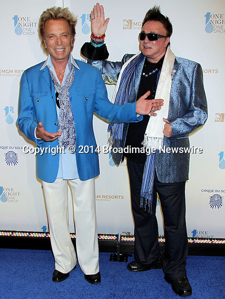 Pictured: Siegfried &amp; Roy<br /> Mandatory Credit &copy; Bim/Broadimage<br /> &quot;One Night For One Drop&quot; by 8 Cirque DuSoleil  Productions <br /> <br /> 3/22/14, Las Vegas, Nevada, United States of America<br /> <br /> Broadimage Newswire<br /> Los Angeles 1+  (310) 301-1027<br /> New York      1+  (646) 827-9134<br /> sales@broadimage.com<br /> http://www.broadimage.com