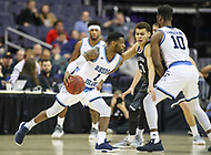 Washington, DC - March 11, 2018: Rhode Island Rams guard Jarvis Garrett (1) dribbles the ball during the Atlantic 10 championship game between Rhode Island and Davidson at  Capital One Arena in Washington, DC.   (Photo by Elliott Brown/Media Images International)