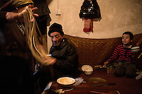 A Uighur family prepares for lunch in their home in Kashgar, Xinjiang, China.