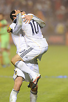 Los Angeles Galaxy's London Donovan jumps in to the arms of David Beckham after beating the Houston Dynamo 1-0 in the MLS Cup at the Home Depot Center. Los Angeles Galaxy 1-0 over the Dynamo USA, Sunday, Nov. 20. 20011, in Carson, California. Photo by Matt A. Brown/isiphotos.com