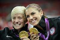 London, England - Thursday, August 9, 2012: The USA defeated Japan 2-1 to win the London 2012 Olympic gold medal at Wembley Arena. Alex Morgan and Megan Rapinoe show off their gold medals. .