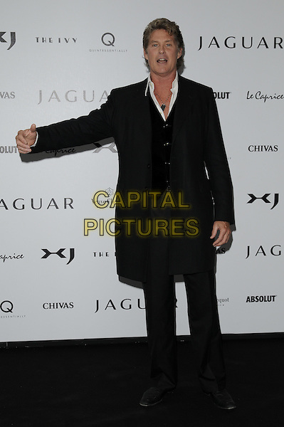 DAVID HASSELHOFF .The New Jaguar XJ launch party, Saatchi Gallery, Duke of York's HQ, London, England. .July 9th, 2009 .full length black coat jacket waistcoat arm outstretched mouth open funny .CAP/CAN.©Can Nguyen/Capital Pictures.