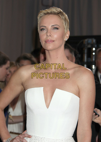 Charlize Theron (wearing Dior Couture).85th Annual Academy Awards held at the Dolby Theatre at Hollywood & Highland Center, Hollywood, California, USA..February 24th, 2013.oscars half length dress white strapless short cropped hair pixie cut .CAP/ADM/RE.©Russ Elliot/AdMedia/Capital Pictures.
