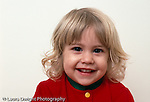 22 month old toddler girl portrait closeup looking at camera horizontal