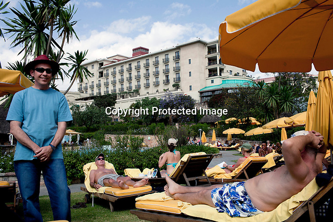 ADDIS ABABA, ETHIOPIA - NOVEMBER 7 : Aid workers and Expats enjoy the pool at Sheraton Hotel on a hot day on November 7, 2010 in central Addis Ababa, Ethiopia. The hotel is one of the most luxurious on the African continent. (Photo by: Per-Anders Pettersson)