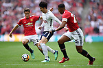 Son Heung-Min of Tottenham Hotspur is challenged by Ander Herrera of Manchester United during the FA cup semi-final match at Wembley Stadium, London. Picture date 21st April, 2018. Picture credit should read: Robin Parker/Sportimage