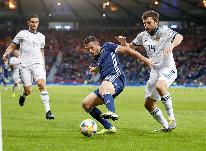 06.09.2019 Scotland v Russia, European Championship 2020 qualifying round, Hampden Park:<br /> John McGinn and Georgi Dzhikiya