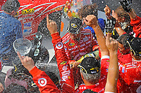 6-8 August, 2010, Watkins Glen, New York USA.Winner Juan Pablo Montoya (#42) sprays the champagne..©2010 F.Peirce Williams, USA.